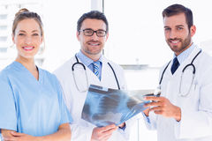 Portrait of doctors with xray report at medical office Royalty Free Stock Photo