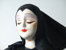 Portrait of doll in black habit Stock Photography