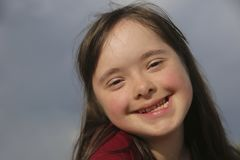 Portrait of down syndrome girl smiling royalty free stock photos