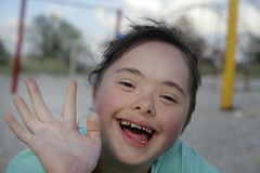 Portrait of down syndrome girl smiling royalty free stock photography