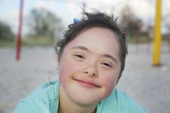 Portrait of down syndrome girl smiling royalty free stock photo