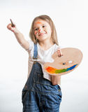 Portrait of drawing little girl holding palette with paints Stock Photography