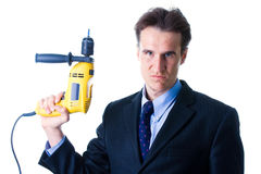 Portrait of dread businessman holding drill. Isolated on white Royalty Free Stock Photography