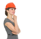 Portrait of dreaming architect woman in helmet Royalty Free Stock Image