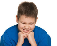 Dreaming boy in blue shirt Royalty Free Stock Photos