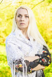 Portrait of Dreaming Caucasian Blond Woman Posing Outside in Fore Royalty Free Stock Image