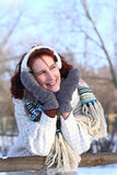 Portrait of dreaming girl in winter park outdoors Royalty Free Stock Images