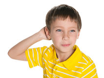Portrait of a dreaming little boy. A closeup portrait of a dreaming little boy on the white background Royalty Free Stock Photography