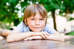 Portrait of dreaming little boy 7 years old outdoors. Portrait of dreaming little boy outdoors in public park Stock Photography