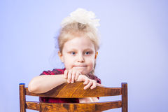 Portrait of dreaming little girl on chair Stock Images