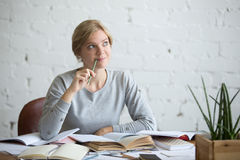 Portrait of a dreaming student woman at the desk Stock Photography