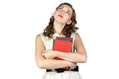 Portrait of the dreaming woman with books Royalty Free Stock Photo