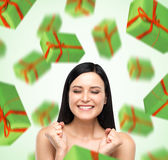 A portrait of dreaming woman with closed eyes who is imagining green gift boxes. Stock Photography