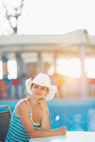 Portrait of dreaming woman at pool bar Royalty Free Stock Image