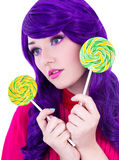 Portrait of dreaming woman with purple hair and colorful lollipo Stock Photo