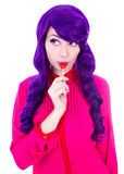 Portrait of dreaming woman with purple hair wig licking lollipop Royalty Free Stock Photos