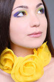 Portrait of dreaming woman with yellow accessory Royalty Free Stock Photos