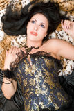 Portrait of a dreamy brunette in a corset Royalty Free Stock Photography