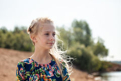 Portrait of dreamy girl with flying hair in wind Stock Images