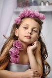 Portrait of dreamy girl with pink flowers Royalty Free Stock Photo