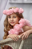 Portrait of dreamy girl with pink flowers Stock Image