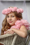 Portrait of dreamy girl with pink flowers. On her head Royalty Free Stock Image