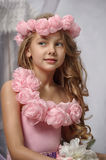 Portrait of dreamy girl with pink flowers Royalty Free Stock Image