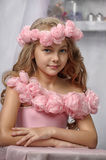 Portrait of dreamy girl with pink flowers. On her head Royalty Free Stock Photography