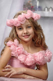 Portrait of dreamy girl with pink flowers Stock Images