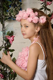 Portrait of dreamy girl with pink flowers Stock Photos