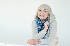 Portrait of dreamy senior woman Stock Image