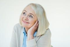 Portrait of dreamy senior woman Stock Images