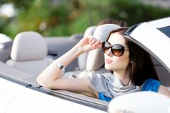 Portrait of dreamy woman in the car Royalty Free Stock Image