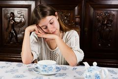 Portrait of a dreamy young brunette with tea cup. Stock Image
