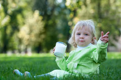 Portrait of a drinking milk in the park Stock Images