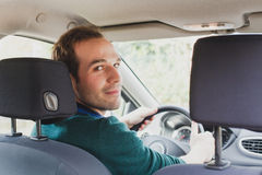 Portrait of driver in the car or taxi. Young caucasian man Royalty Free Stock Images