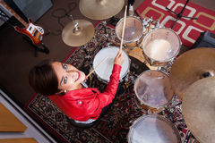 Portrait Of Drummer Performing In Recording Studio. High angle portrait of female drummer performing in recording studio Royalty Free Stock Photography
