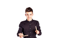 Portrait of a drummer playing with drum stick wearing black in studio Stock Photos
