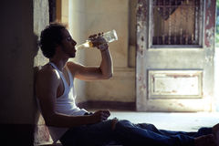 Portrait of drunk male alcoholist drinking whiskey Royalty Free Stock Photos