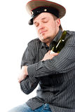Portrait of a drunk man hugging a bottle Stock Photography