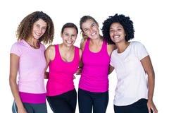Portrait du groupe de sourire de femmes avec des bras autour Image libre de droits