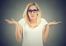 Portrait dumb looking woman arms out shrugs shoulders I don`t know. Negative emotion body language. Portrait dumb looking woman arms out shrugs shoulders I don`t royalty free stock photos