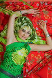 Portrait of east woman. Portrait of beautiful east tsarina, on the Persian carpet Royalty Free Stock Images