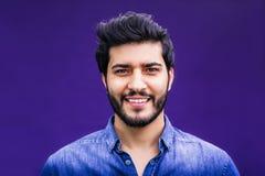POrtrait of Arabian Man. Portrait of eastern arabian man on purple background Royalty Free Stock Photo