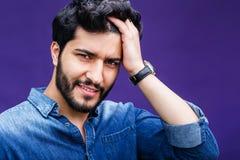 POrtrait of Arabian Man. Portrait of eastern arabian man on purple background Stock Image
