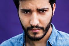 POrtrait of Arabian Man. Portrait of eastern arabian man on purple background Stock Photos
