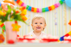 Portrait of eat smeared baby celebrating birthday Stock Photos