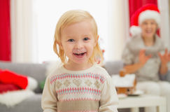 Portrait of eat smeared baby enjoying Christmas Stock Photography