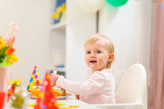 Portrait of eat smeared kid eating birthday cake Royalty Free Stock Photos