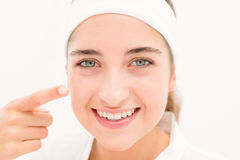 Portrait eautiful smiling woman Mid section of woman applying cream Royalty Free Stock Image